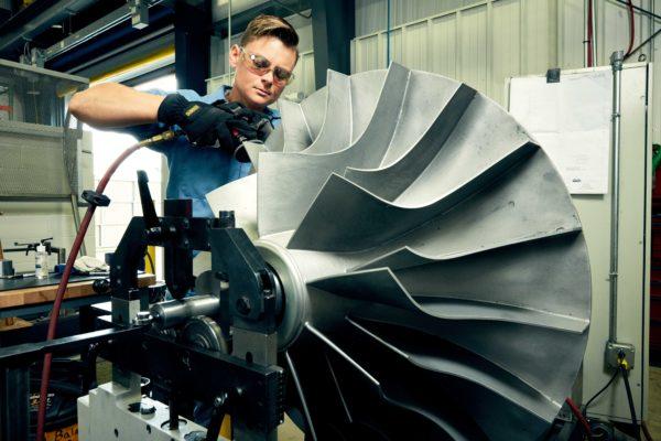Machine shop technician, Rachel Maxwell, molding a GII-E impeller