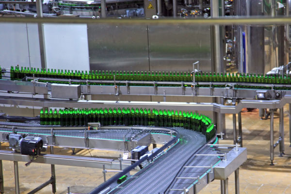 A production conveyor belt with bottles for the food and beverage industry